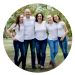 Outdoor photographic of a Family of 5 with 3 teenage daughters standing and smiling straight to camera all dressed in white t-shirts and jeans. Round image as showcased in our work